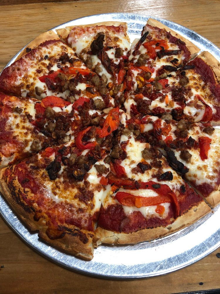 Food from Sauced: Craft Pizza, Pasta, & Salad