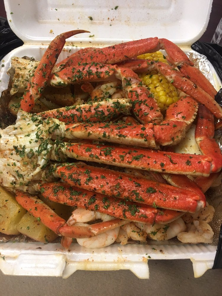 Crab legs, shrimp, potatoes & sausage  The egg always throws
