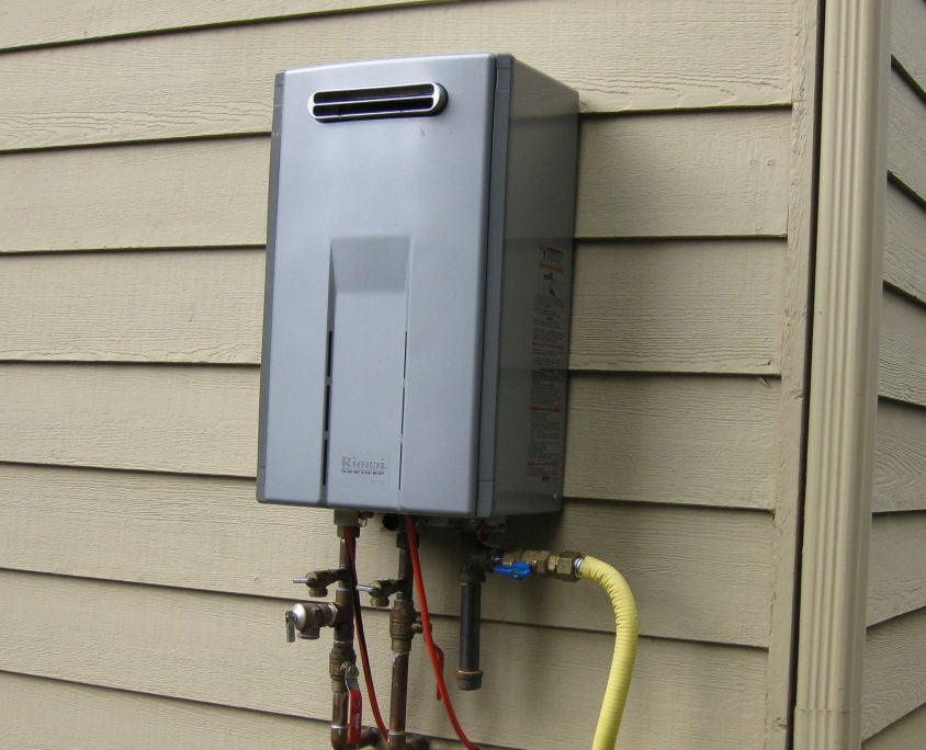 a tankless water heater installation on the outside of the house. - yelp