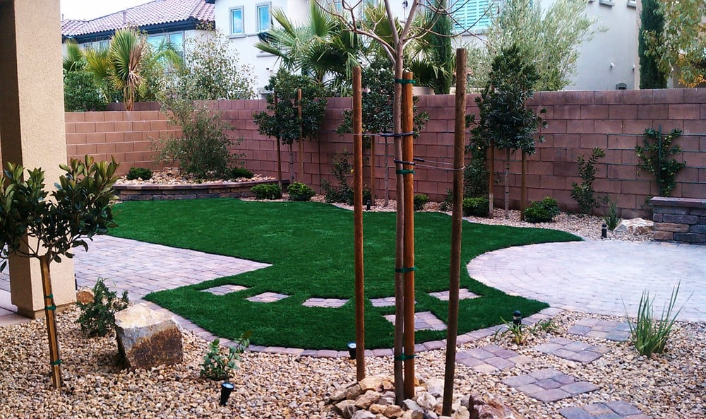 Pet friendly back yard with syn grass pavers water wise for Garden city pool jobs