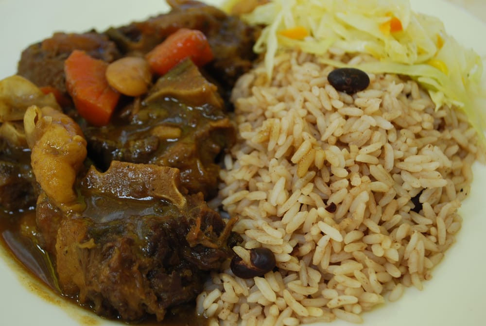 oxtail with rice and peas and cabbage  yelp