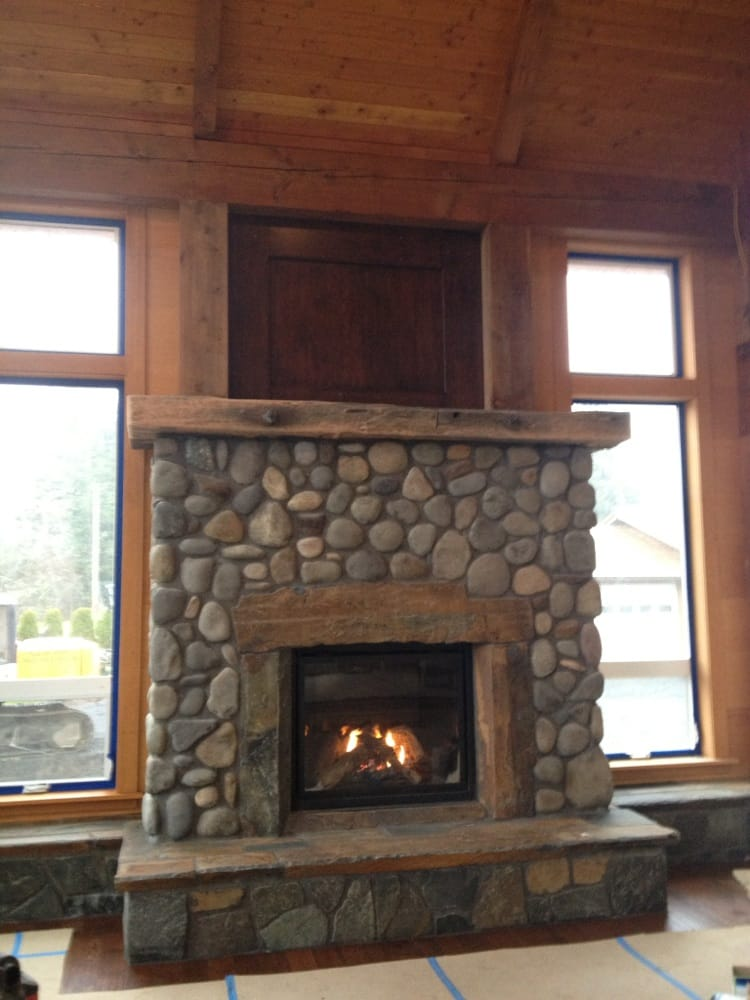 Custom river rock fireplace in timber frame home yelp for Wood frame house in florida