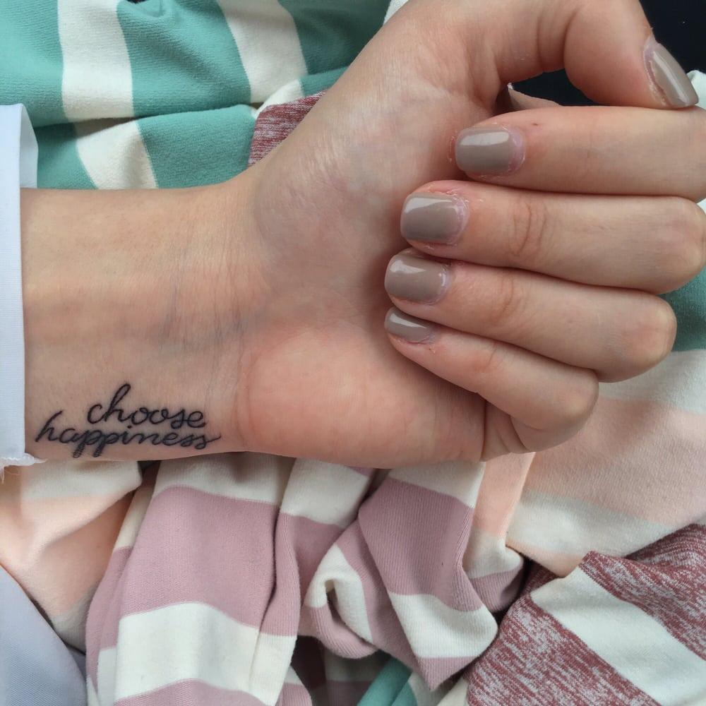 Small Script Tattoo: Small Script Wrist Tattoo