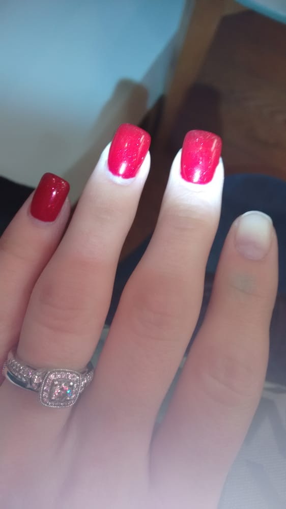This is my nail coming off after just one week getting them done. - Yelp
