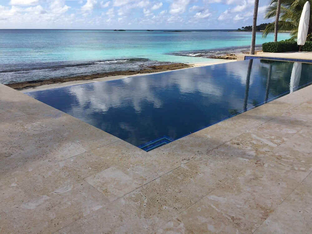 Infinity Edge Pool With Coralina Stone Pavers Installed In