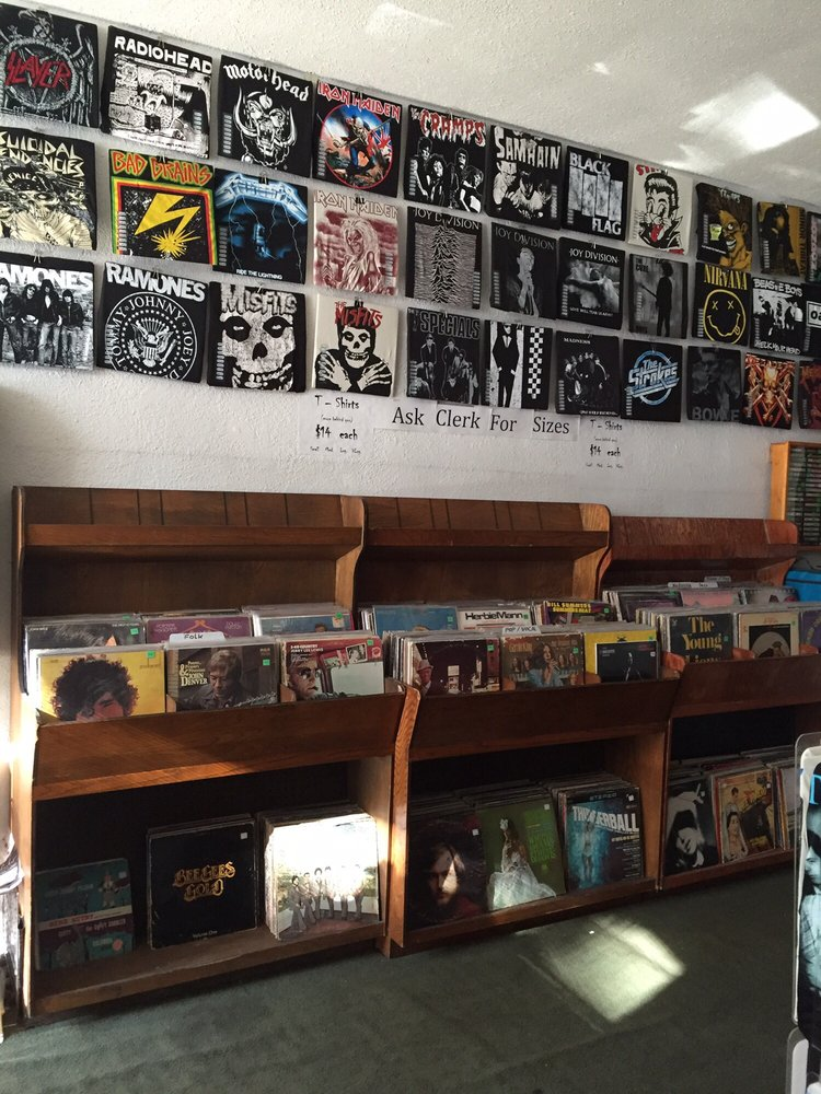 Zoinks Record's wall lined with metal tees