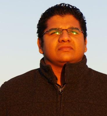 Suraj B.